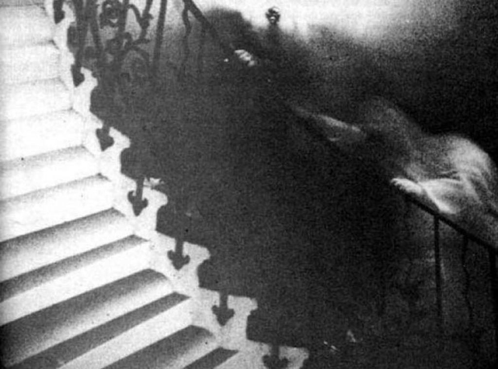 The Tulip Staircase Ghost Photo. Does it show a backward arm or possibly two ghosts?