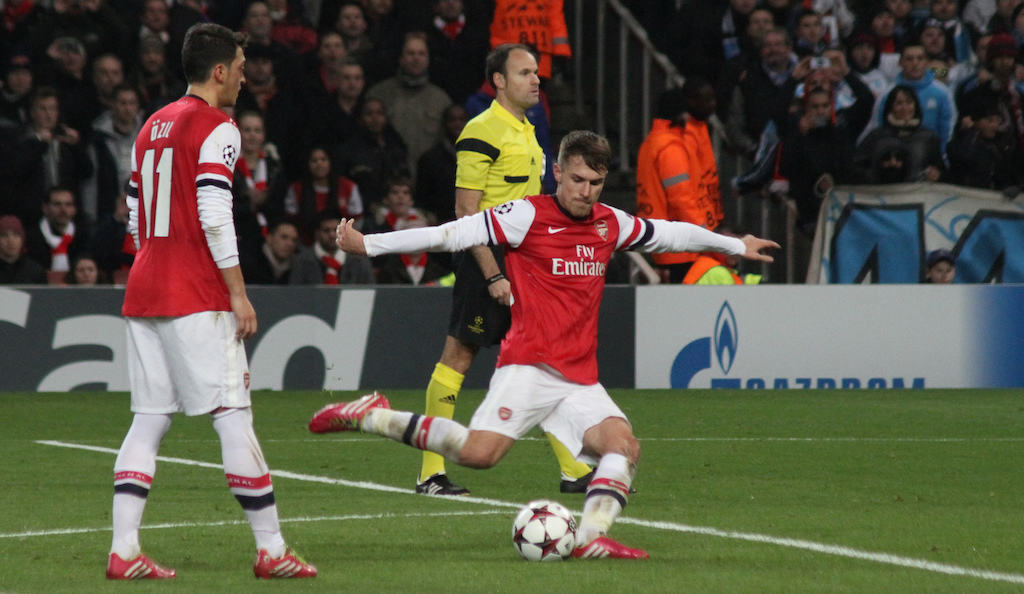 "Aaron Ramsey going for a free kick. CC2.0 <a href=""https://www.flickr.com/photos/ronmacphotos/"