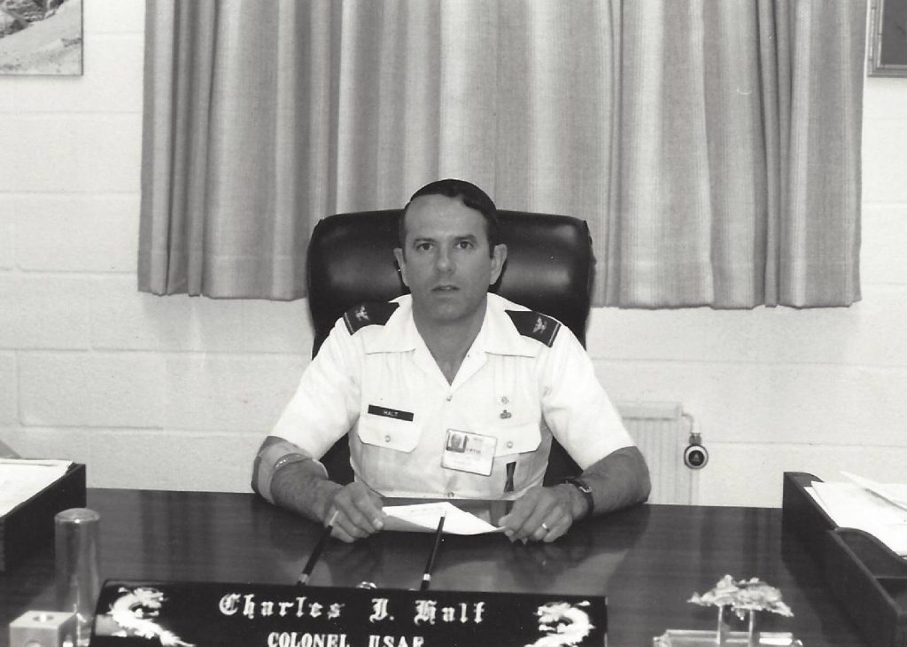 "Colonel <a href=""http://www.charleshalt.com/"" target=""_blank"" rel=""noopener"">Charles Halt</a> at his desk."