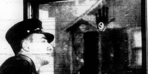 Irremovable handprint of Francis Leavy on the Chicago Fire Department window.