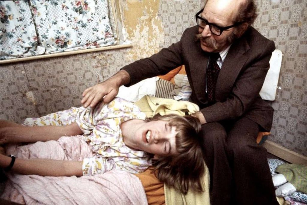 The Enfield poltergeist apparently at work. Maurice Grosse and Janet Hodgson.