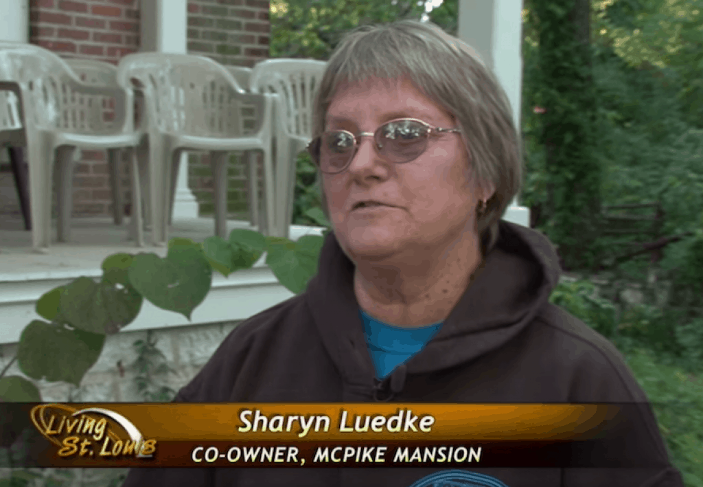 Video still of Sharyn Luedke discussing the ghostly sounds emanating from the McPike mansion.